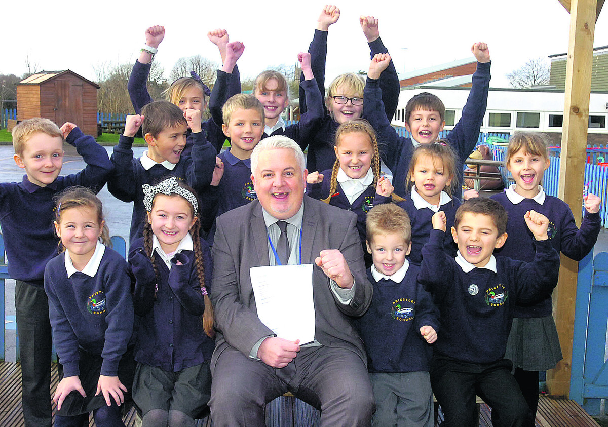 Headteacher Andrew Marsh-Ballard and pupils celebrate their Ofsted success