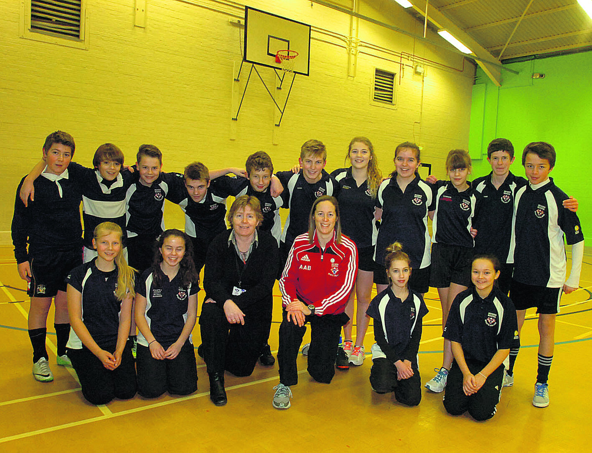 Department head Sue Marshall and faculty head Ali Beck celebrate with Devizes School students