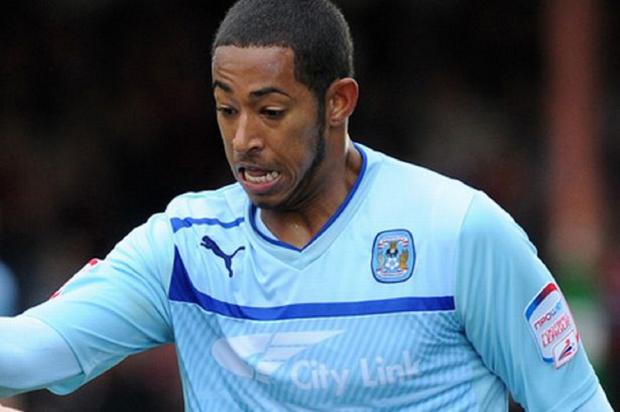 Jamie Reckord has joined Swindon Town on a 93-day loan deal