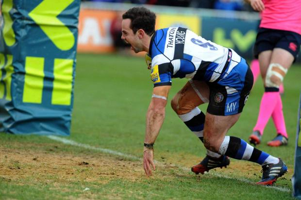 Scrum-half Micky Young celebrates his try against Cardiff (Photo: Bob Ascott)