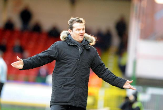 Swindon Town manager Mark Cooper granted Celvin Kalinga a trial after he turned up at the club's Liddington training ground