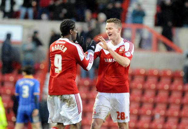 Swindon Town's Nile Ranger and Michael Smith