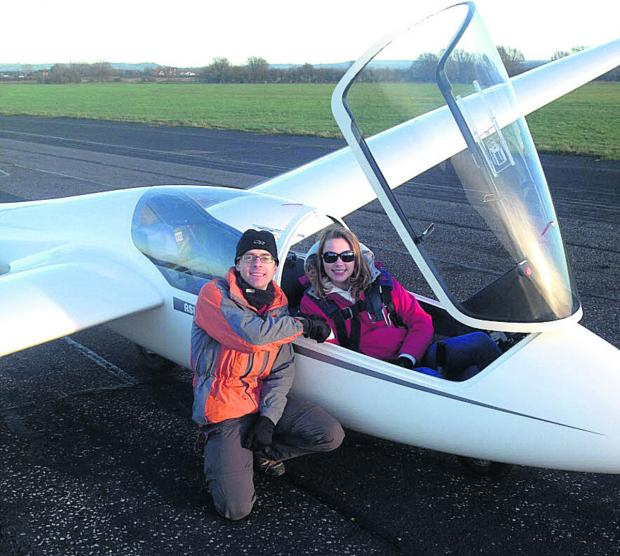 Charlotte Acton, 14, is congratulated after her first solo flight by instructor Wing Commander Carl Peters