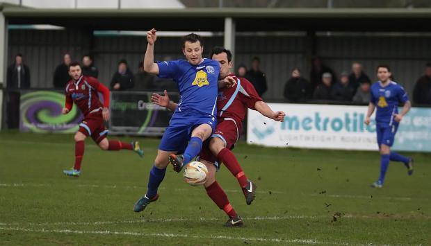 Chippenham Town's Callum Wright battles for the ball in last week