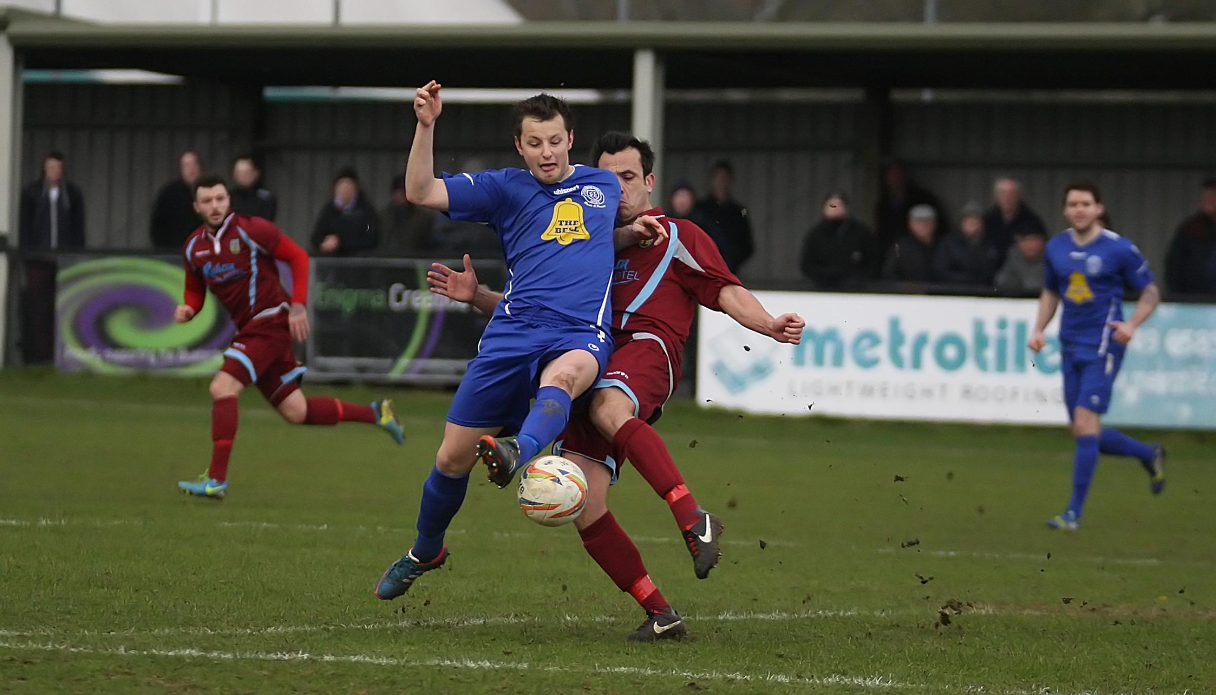 Chippenham Town's Callum Wright battles for the ball in last weekend's 2-1 win over Weymout
