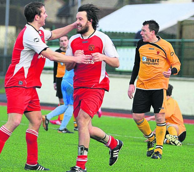 Corsham Town hat-trick hero Booker Woodford (above) celebrates one of his three goals at Keynsham Town last weekend