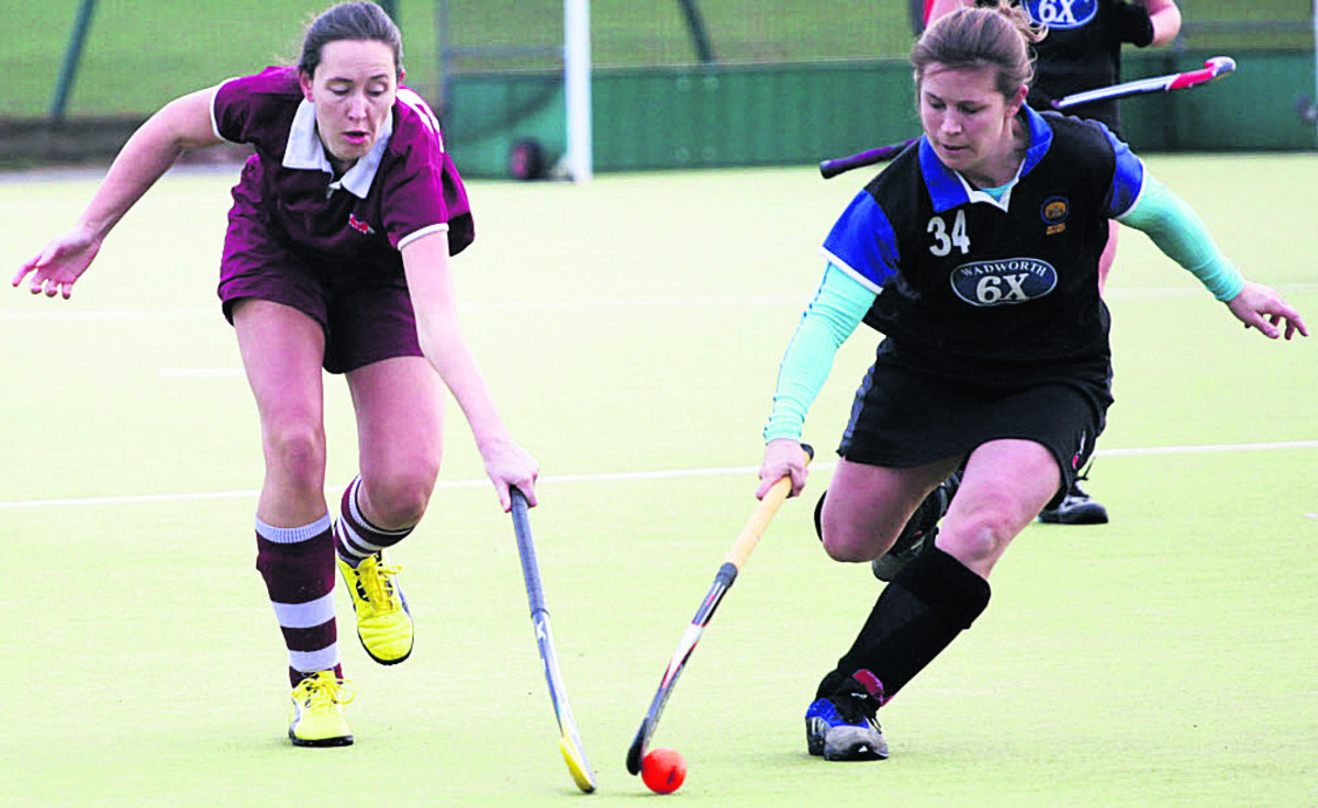 Devizes' Jennie Holloway (right) battles with Melksham's Laura Mizen during the sides' Wessex Division One clash that leaders Devizes won 2-0