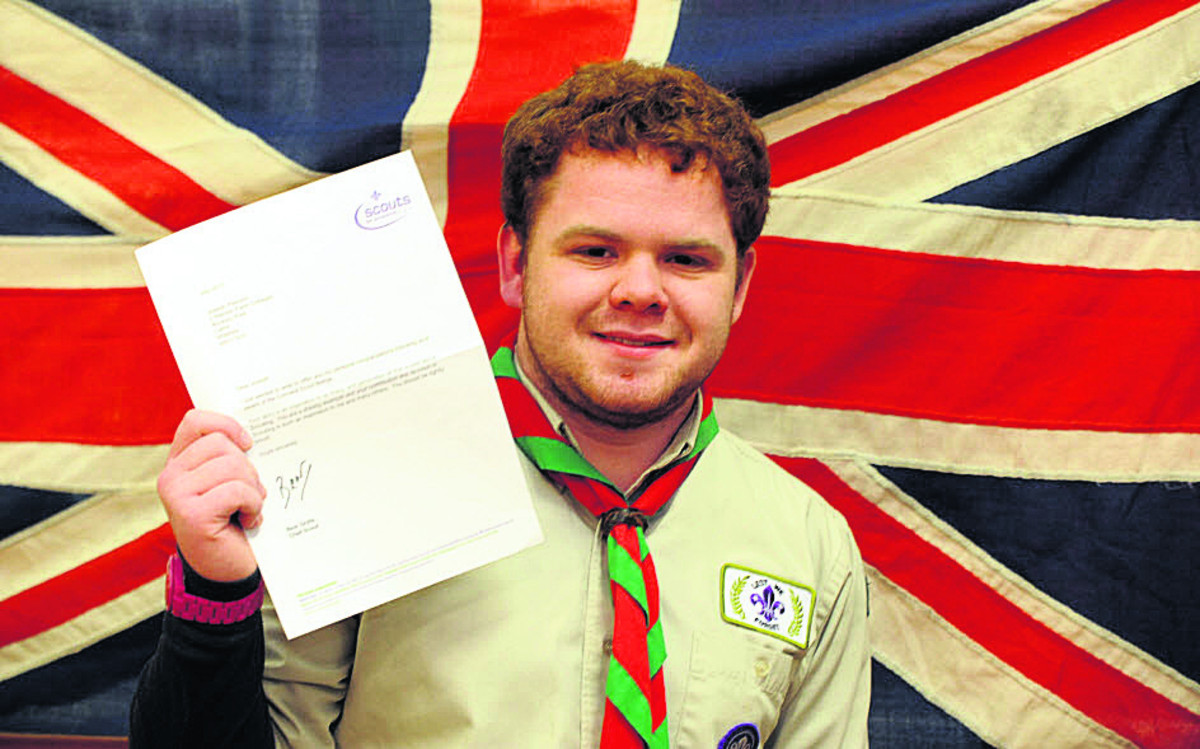 Joe Pearson, with the letter he received from Chief Scout Bear Grylls. He has been awarded the Cornwell badge for dedication to Scouting and courage