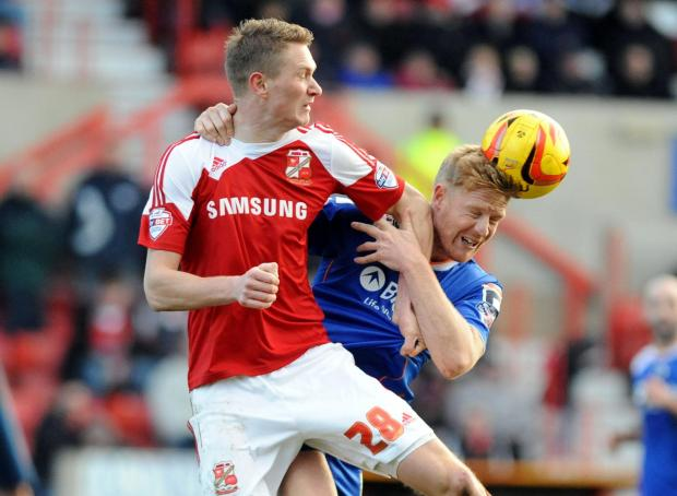 The Wiltshire Gazette and Herald: Town striker Michael Smith is relishing the local derby