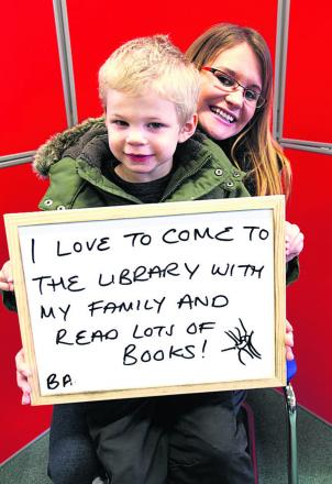 Alisha and Finley Chapman with their message of support at Chippenham Library
