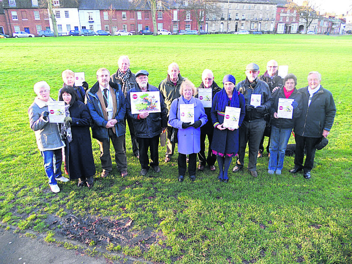 Protesters against the Coate Bridge plan gathered on the Green with posters ahead of a rally in December 2012