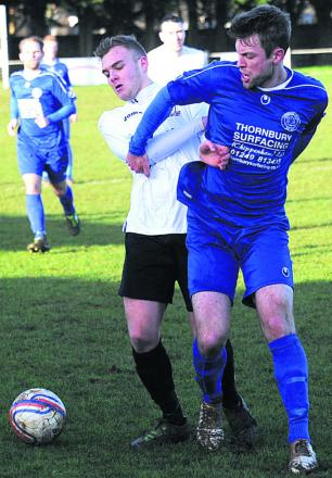Calne's Tom Boakes (white) battles with Chippenham Park's Phil Baker during Saturday's derby