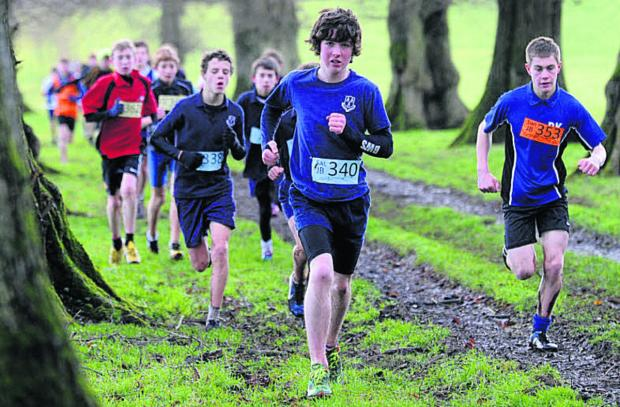The Wiltshire Gazette and Herald: Junior boys competitiors make their way through an avenue of trees at Grittleton House School on Saturday