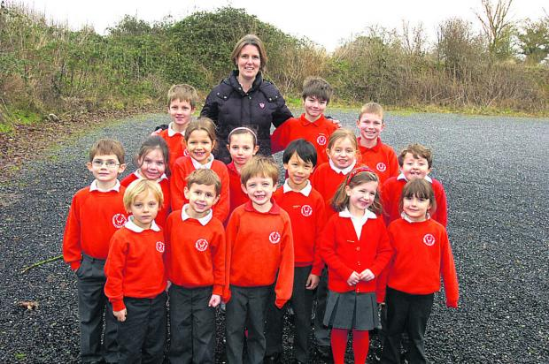 Head of governors Sam Wolcough with children at the new play site