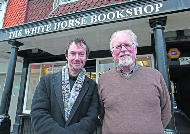 New manager Angus MacLennan with Michael Pooley, the outgoing owner of the White Horse Bookshop