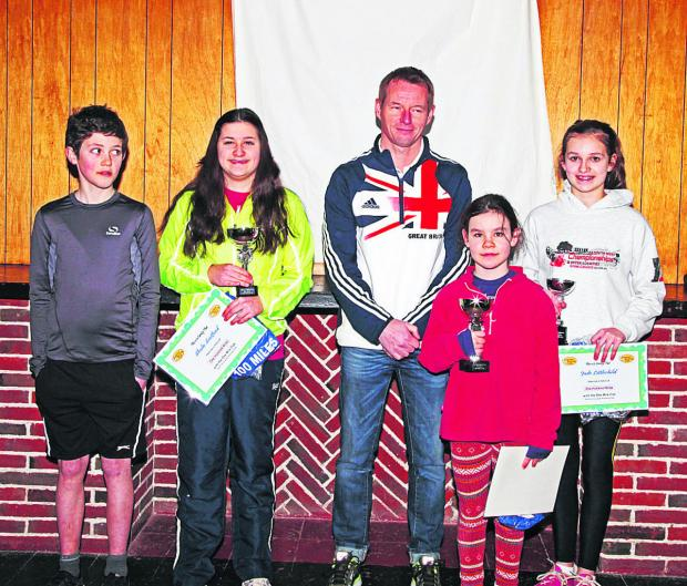The Wiltshire Gazette and Herald: England Athletics coach Martin Rush meets young runners Christopher Sapiano, Shula Scotford, Zoë Stansfield-Cox and Jade Littlechild