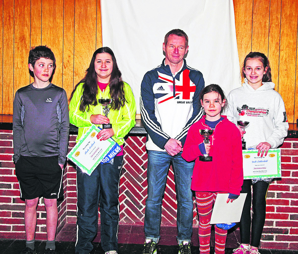 England Athletics coach Martin Rush meets young runners Christopher Sapiano, Shula Scotford, Zoë Stansfield-Cox and Jade Littlechild