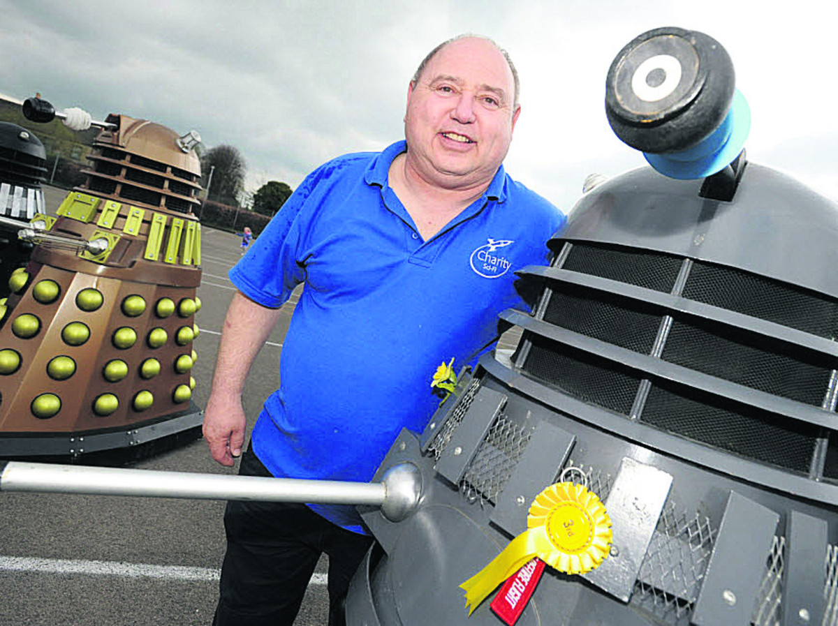 Sci-fi fan Ady Davies with Daleks similar to those expected at Lacock Abbey this half-term