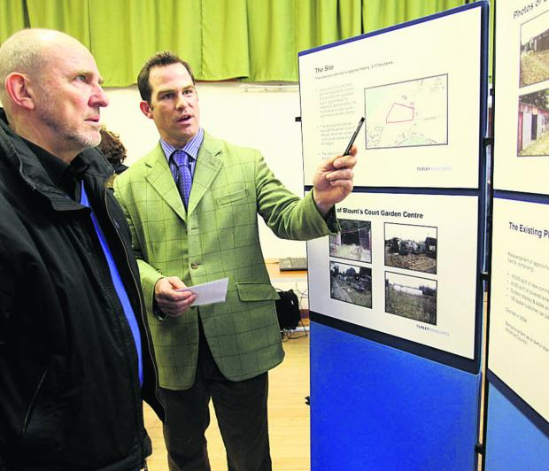 Bowood Estate manager Charles Leather, right, speaks to residents about plans for homes on a former nursery site at Studley