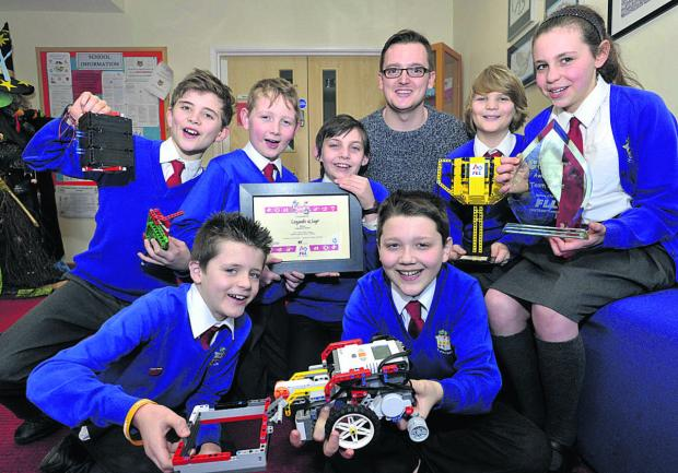 The Wiltshire Gazette and Herald: Teacher Aaron Laws with pupils William, Joe, Zack, Zachary, Kazi, Matthew and Beth
