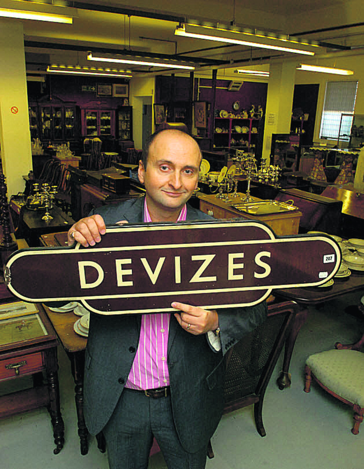 Andrew Aldridge with the Devizes station sign which is going under the hammer on Saturday