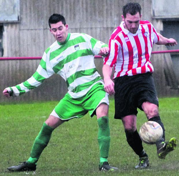 The Wiltshire Gazette and Herald: Devizes Town's Jamie McLaughlin (right) battles with Almondsbury UWE's Simon McAvoy during Saturday's defeat for the home side at Nursteed Road     Picture by Vicky Scipio (VS161-2)