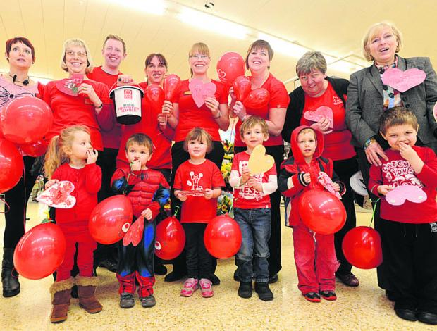 Chippenham Sainsbury's staff and children from the Busy Bees Nursery dress up to support the BHF on Valentine's Day. Back, Molly Randell, Lesley Hern, Greg Rochester, of Sainsburys, Claire Fern, Sam Hey, Amanda Houston, Lyn Gardener and Wendy Massingham