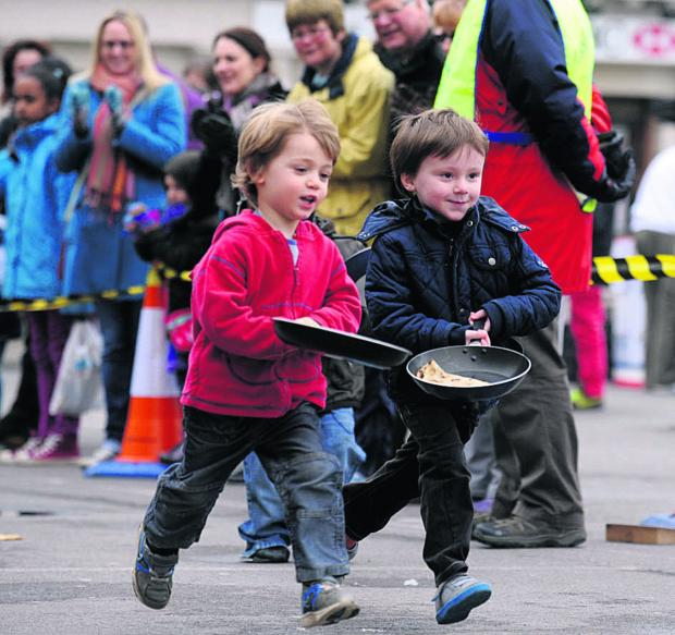 Pancake races in Devizes Market Place attracts all ages