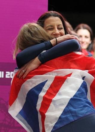 Shelley Rudman congratulates Olympic champion Lizzy Yarnold after today's skeleton finale