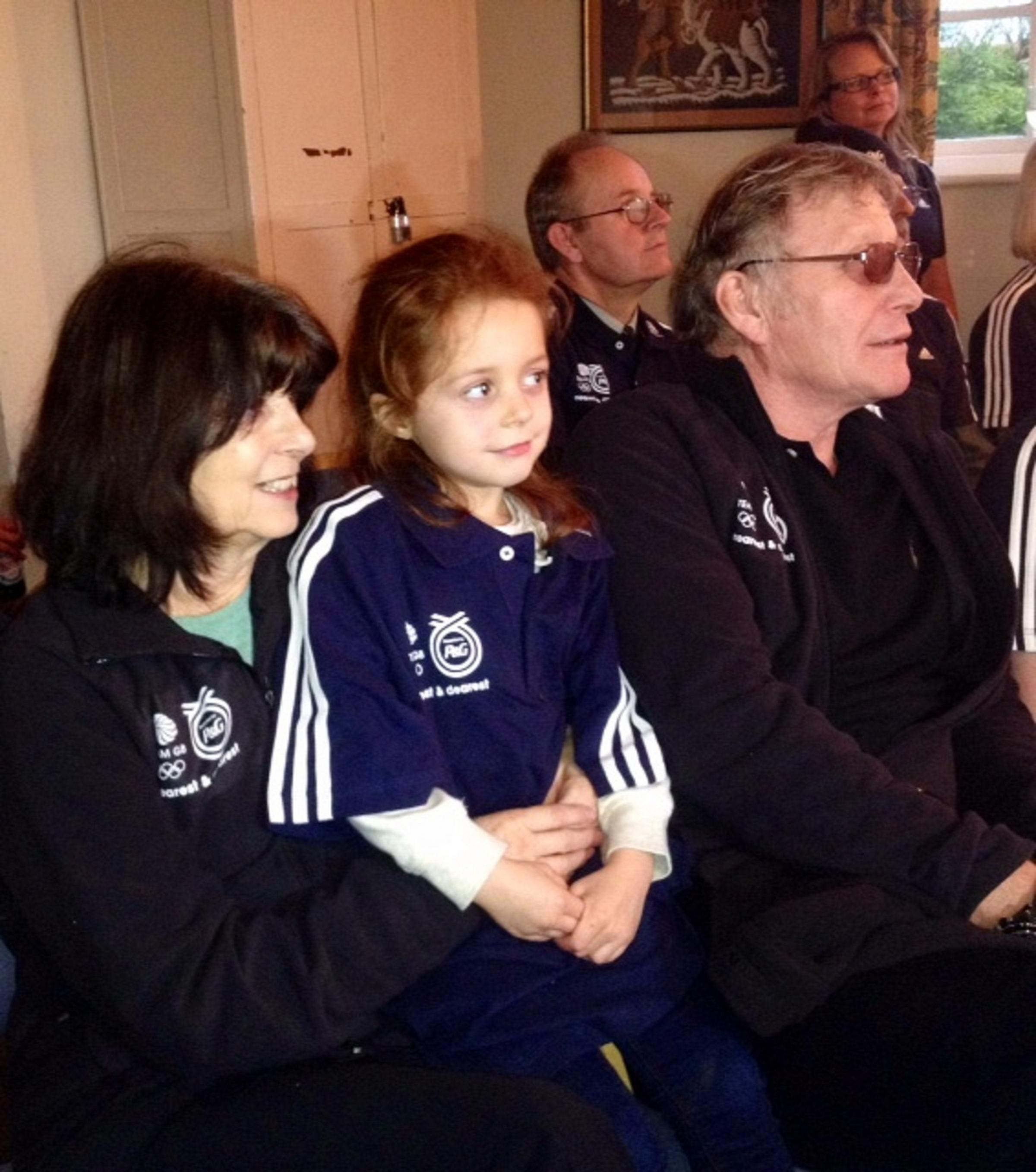 Shelley Rudman's daughter Ella, mum Josie and dad Jack watch her in action in Sochi in Pewsey today
