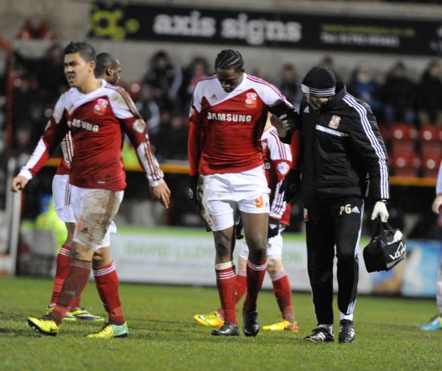 The Wiltshire Gazette and Herald: Nile Ranger hobbles off during last night's 0-0 draw