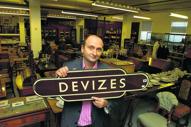 The Wiltshire Gazette and Herald: Andrew Aldridge with the Devizes station sign which sold at auction