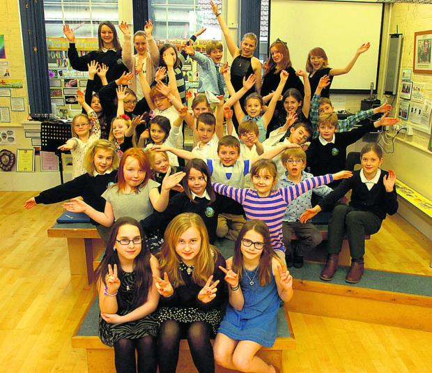 The Wiltshire Gazette and Herald: Lea and Garsdon Primary School pupils line up a show for the Philippines disaster appeal