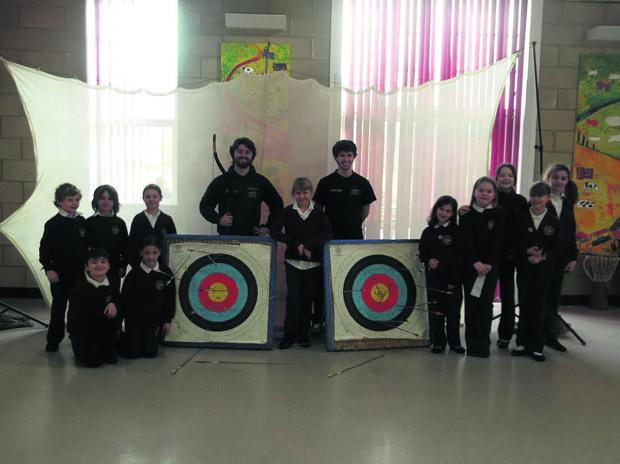 Children take part in archery sessions at Rushall Primary School