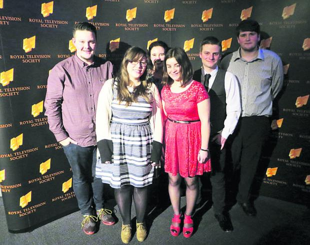 Presenters Lewis Spence and Jake Smith flank fellow production team members Hayley Cartwright, Helena Hawkins and Conor Shutler, with lecturer Nicola Dew behind them