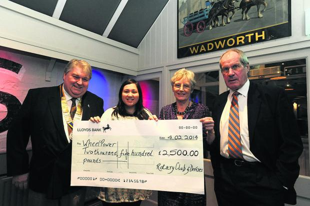 Devizes Rotary president Colin Lugg and WheelPower's Emma Lau with Jean Allen and Colin Clapshoe, right