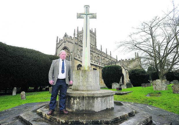 Coun Alan Hill at the war memorial in St Mary's Church, Calne