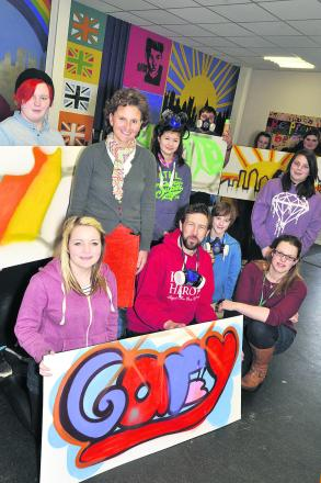 Coun Laura Mayes, top second left, dropped in at Devizes Youth Centre on Tuesday to meet teenagers  and staff taking part in a Street Art workshop run by  Alex Miles, front centre, with  team leader Sarah Howse, bottom right PICTURE BY GLENN PHILLIPS (491
