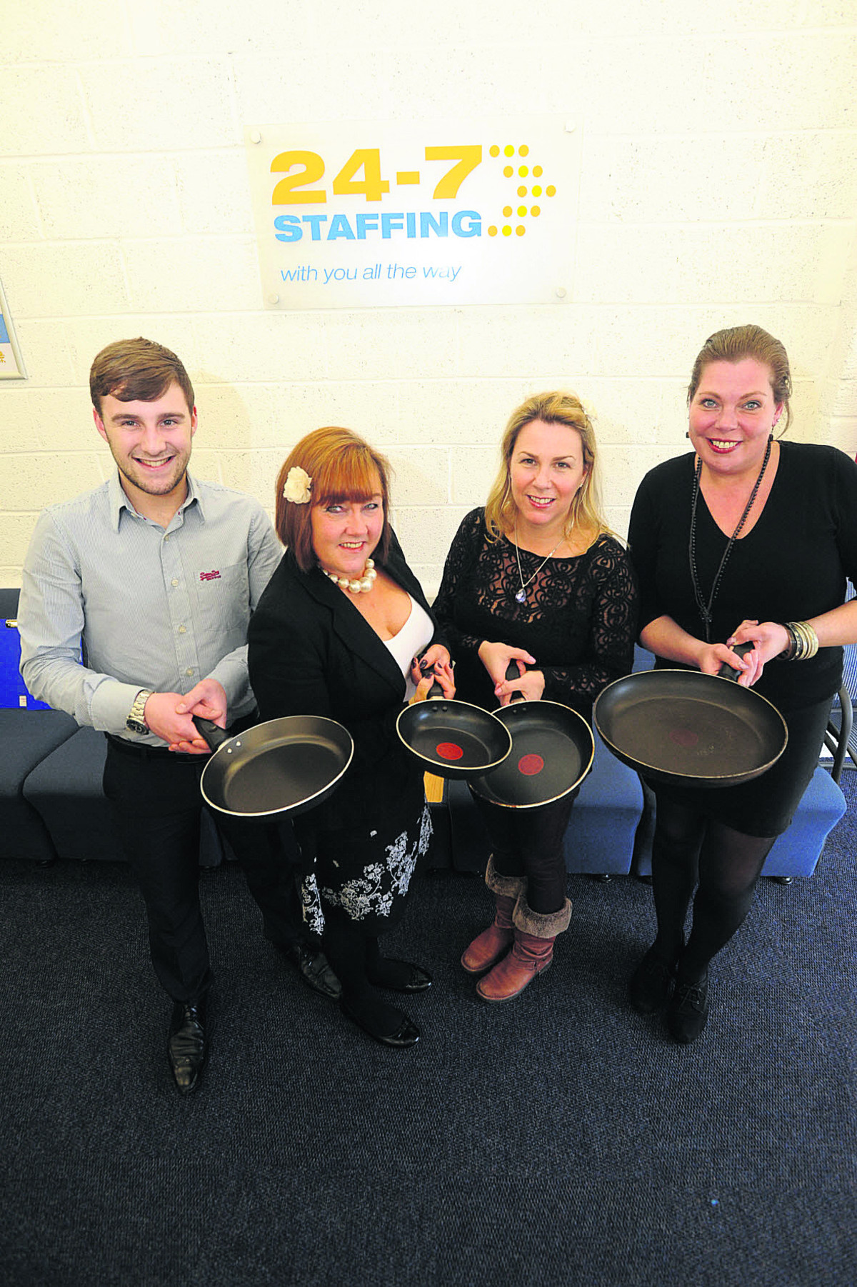 Staff from 24/7 Staffing, from left, Joshua Thompson, Lisa Waters, Melody Thompson and Jo Ball gear up for the pancake race