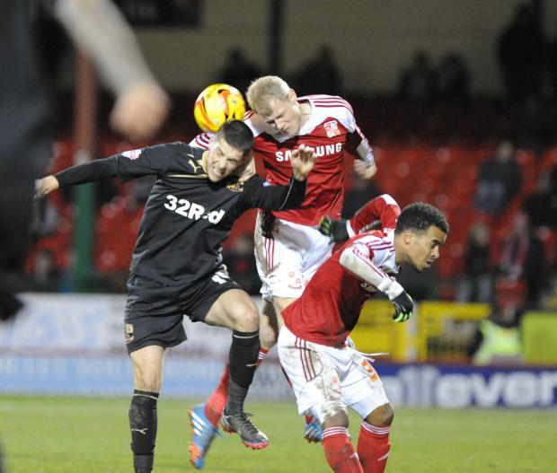 Swindon Town's Jay McEveley in action against Crawley last night