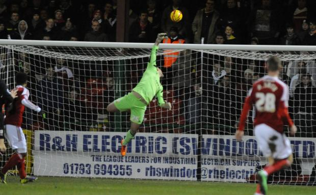 Swindon Town's Tyrell Belford in action against Crawley last night