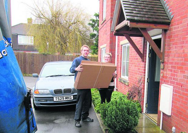 Matt Rose helps deliver the boxes from D S Smith to Laura Self at her home in Trowbridge