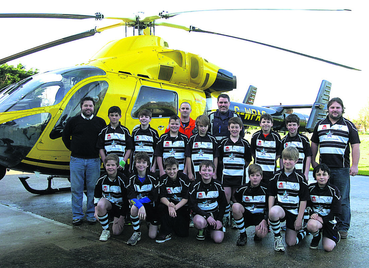 The fundraising Chippenham under-12s rugby team with, back row, coach Dean Alkin, Matt Baskerville, Nigel Gilbert, coach James Harding and the Air Ambulance