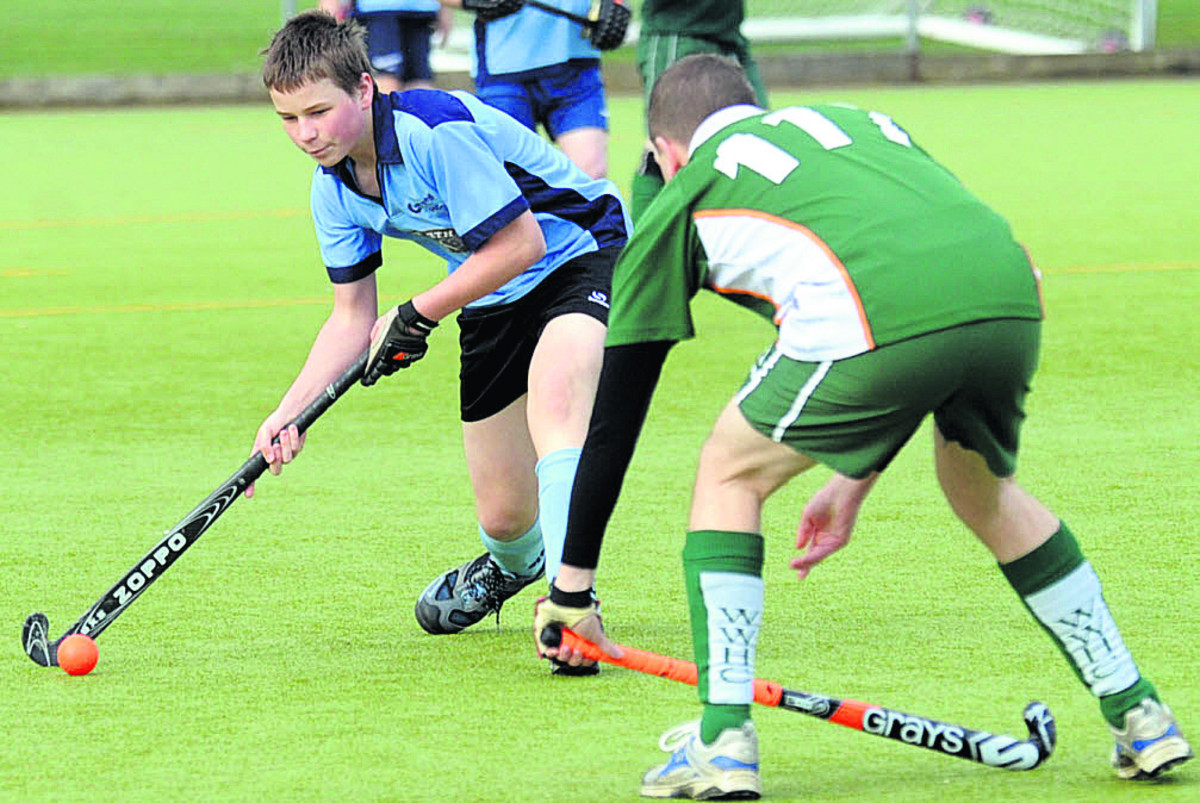 Chippenham C's Ben Law (blue) take on an opponent during his side's 3-1 defeat to West Wilts E in East Central Two on Saturday