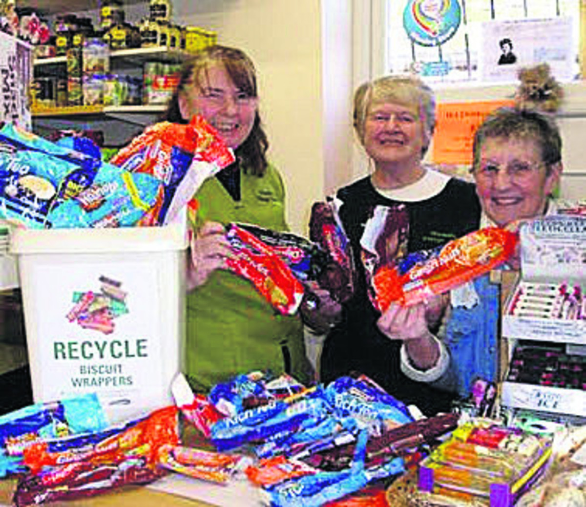 Veronica Seedhouse, Maggi Francis and Jan Barber from the Rowde Village Shop with some of the used biscuit wrappers they have saved from landfill as part of the Wrappers to Riches Collection Contest