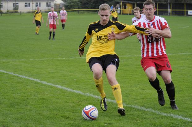 Dan Kovacs (yellow) netted twice for Melksham Town in last night's 6-0 win against Hengorve Athletic