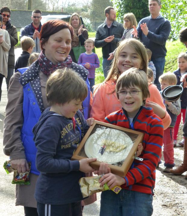 The Wiltshire Gazette and Herald: The Kington Langley Pancake Plate winners Oliver Mathewson, Jenny Stables, Ben Cunningham and Helen Mathewson
