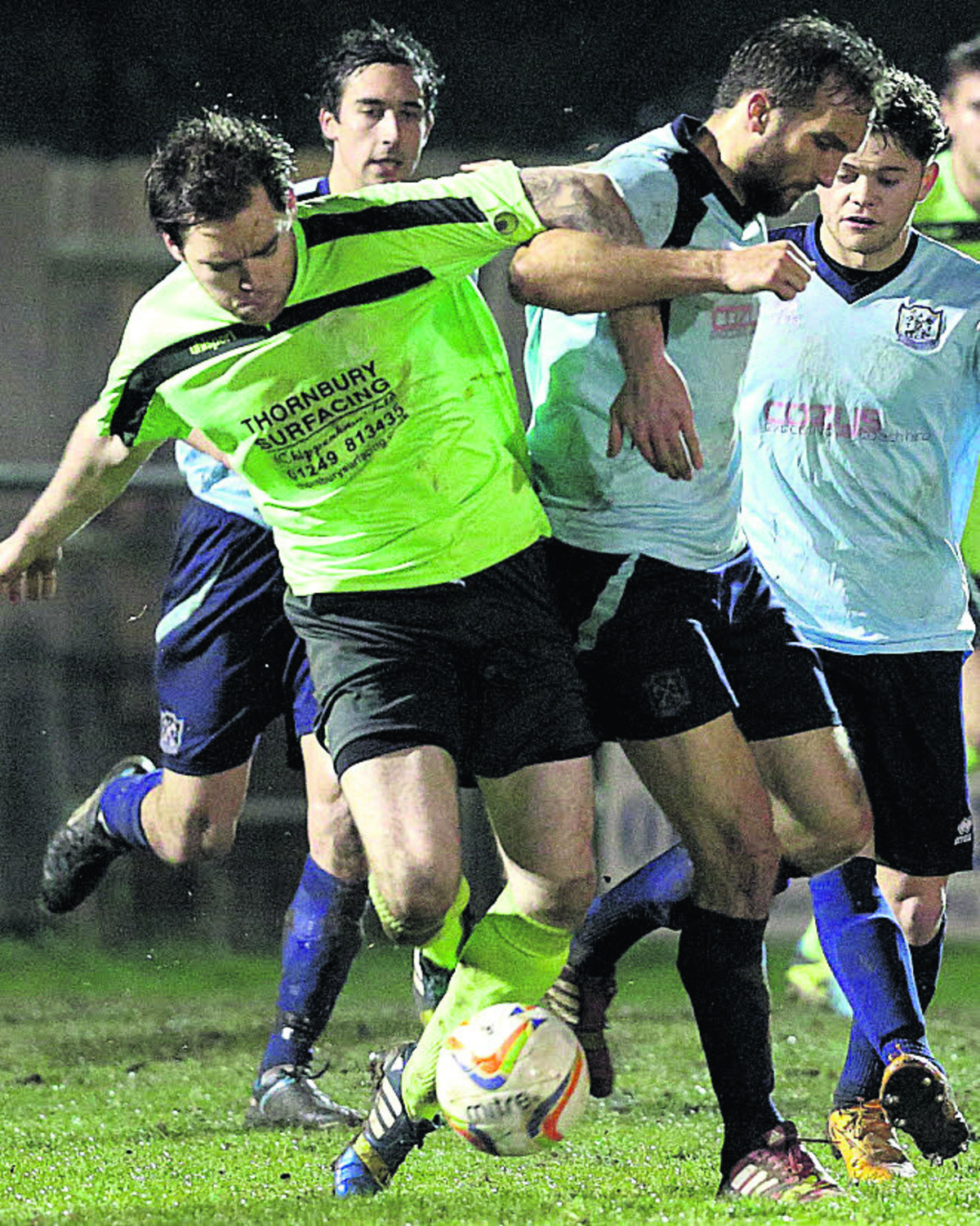Greg Tindle battles for possession during yesterday's defeat at Arlesey (Picture by Chippenham Town FC)