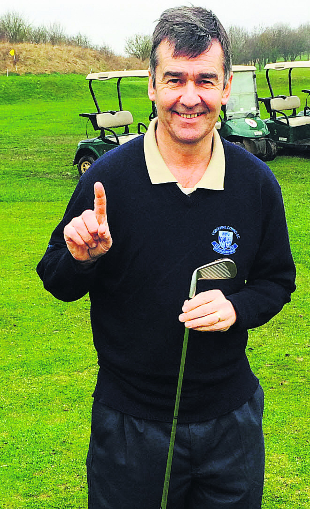 Dave Myler celebrates his ace at the 17th hole at the Ogbourne Downs club, near Marlborough