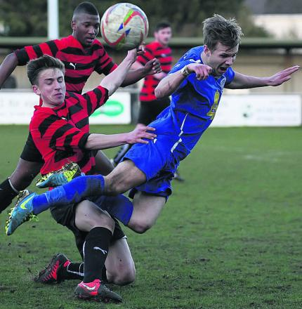 Chippenham Town's Joe McClennan takes a tumble under pressure from Burnham's George Pilbeam during the Bluebirds' 2-1 win at Hardenhuish Park on Saturday
